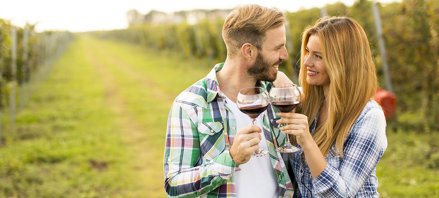 Couple tasting wine at a winery