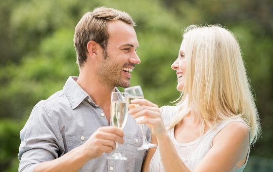 Couple toasting with champagne flutes