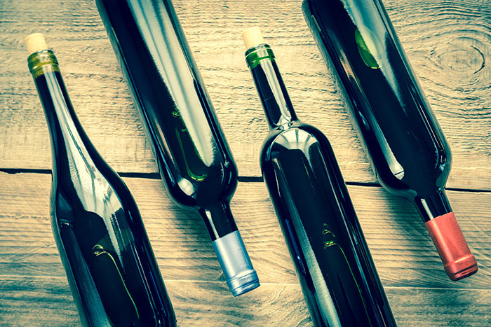 Wine bottles on a wooden table