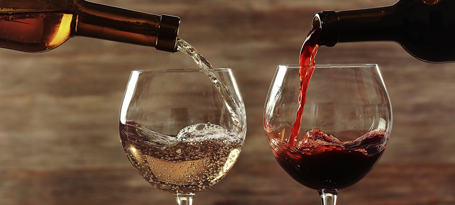 White and red wines being poured into glasses