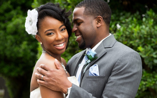 Portrait of an African American bride and groom.