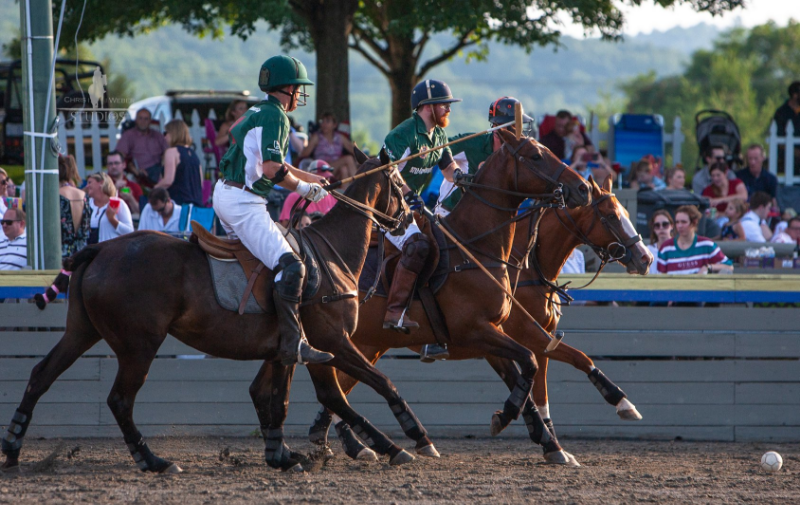 Two Players Playing Twilight Polo at Greenhill Stadium