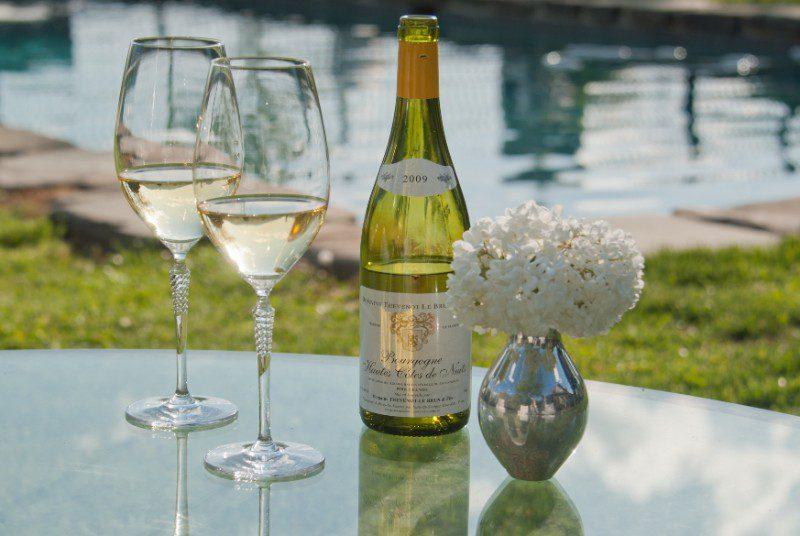 wine glasses poolside