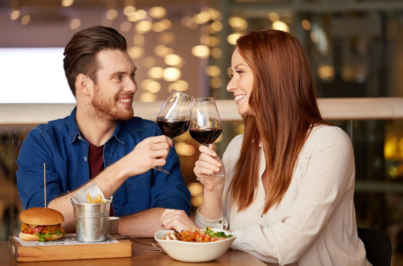 couple drinking red wine and dining