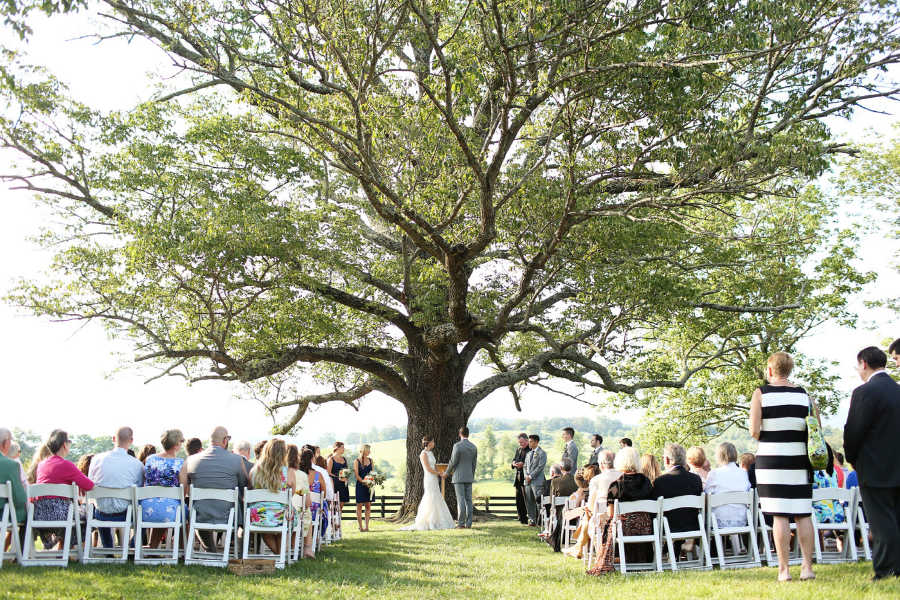 Big wine country wedding ceremony at Glen Gordon Manor, under giant tree