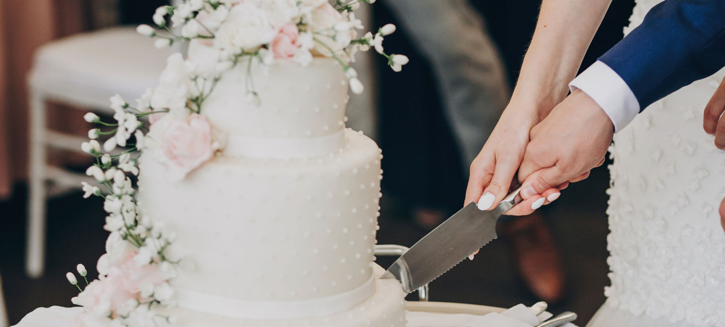 Bride And Groom Holding Knife And Cutting Stylish White Wedding