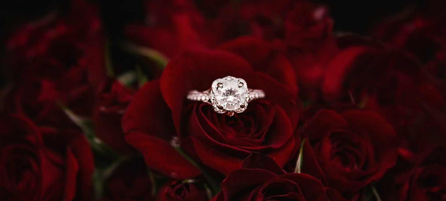 Gorgeous diamond engagement ring in a bouquet of roses