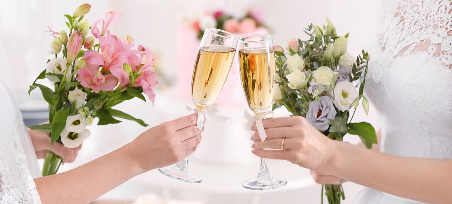 Brides toasting with champagne