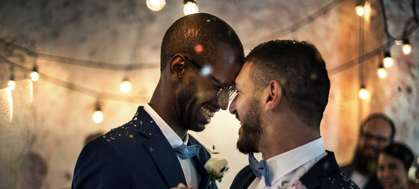 smiling grooms in love at a wedding